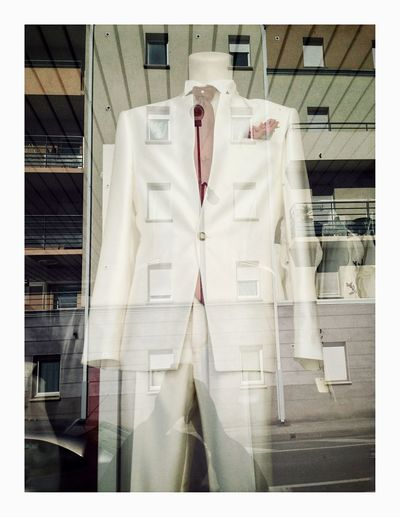Pocket Man Window Reflections Architecture Coathanger Hanging Day Built Structure No People Indoors  Close-up