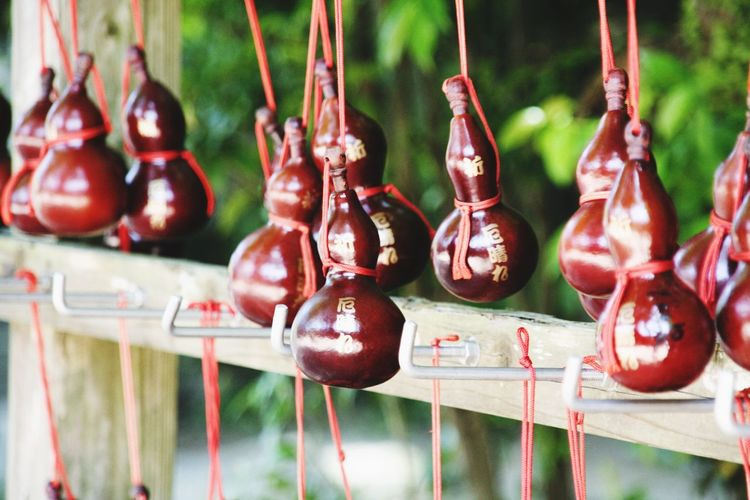 Religious offerings hanging from rack at temple