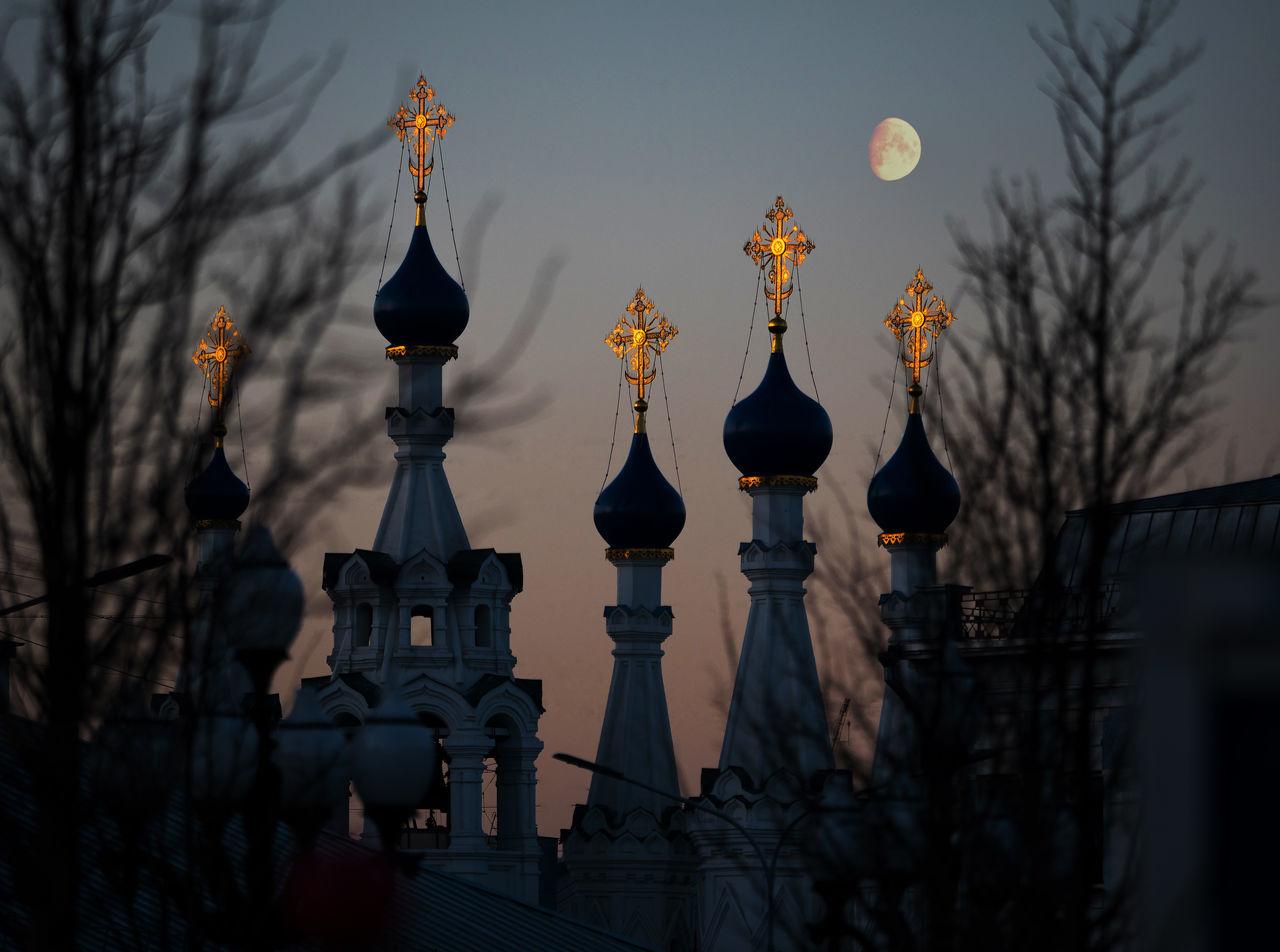 Church against sky at dusk