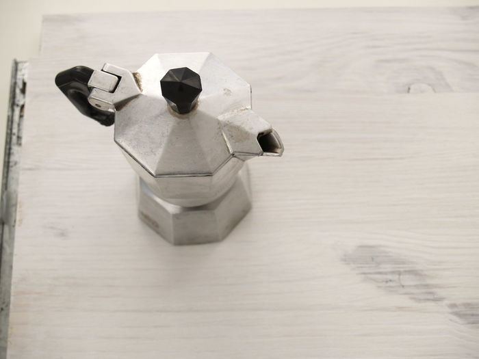 High Angle View Of Moka Pot On Table