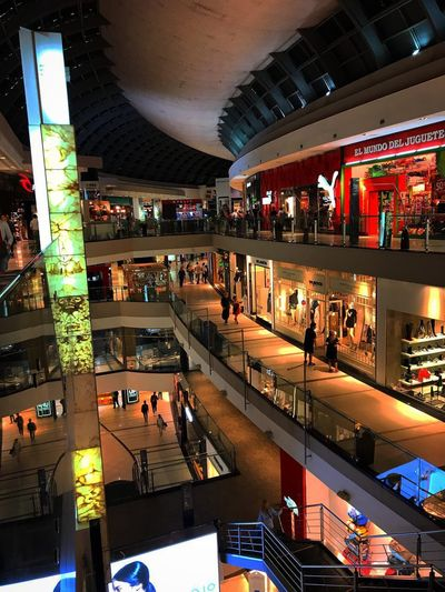 Mall Architecture Illuminated Large Group Of People Crowd Built Structure City Night Group Of People Real People High Angle View Incidental People Store Shopping Mall Lifestyles Lighting Equipment Retail  Shopping Women Modern Transportation