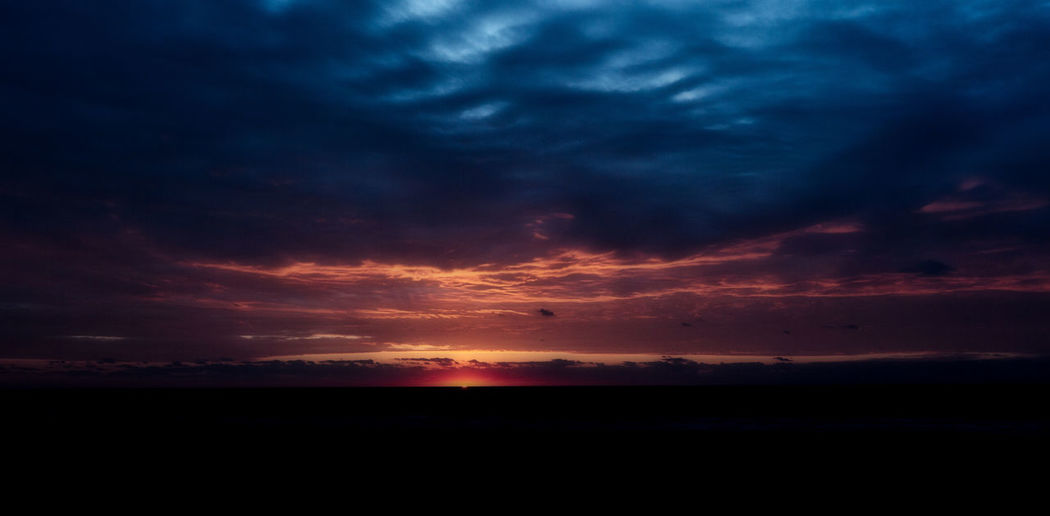 Perspectives On Nature Beauty In Nature Dark Dramatic Sky Dusk Horizon Nature No People Outdoors Scenics Sea Silhouette Sky Sunset Tranquil Scene Tranquility Water