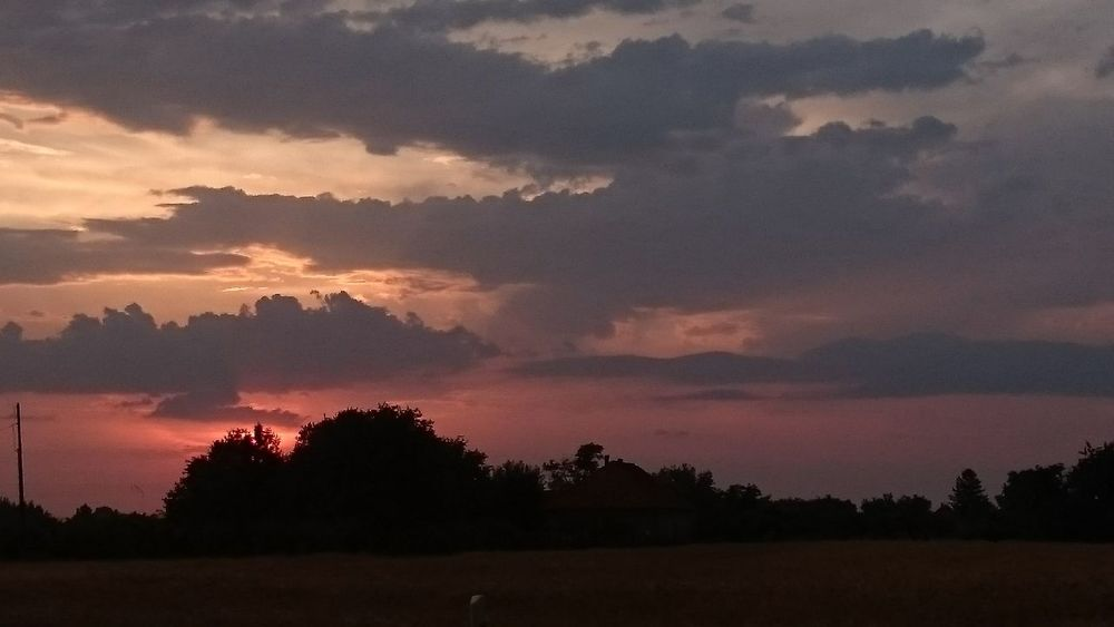 Beauty In Nature Cloud Cloud - Sky Cloudy Dark Dramatic Sky Field Growth Idyllic Landscape Nature Non-urban Scene Orange Color Outdoors Remote Rural Scene Scenics Sky Sunset Tranquil Scene Tranquility Tree Weather