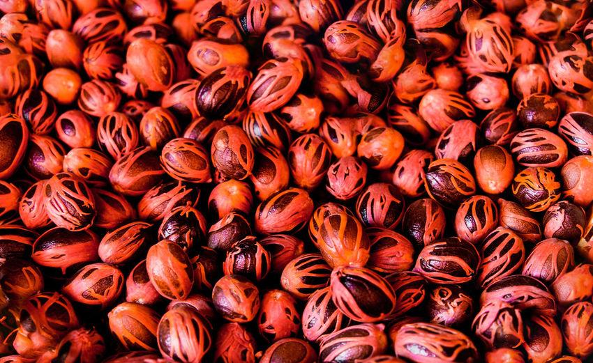 Full frame shot of nutmegs for sale at market