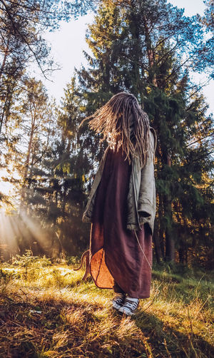 Young woman with dreadlocks in autumn fall forest in the morning sunshine Fall Fall Forest Autumn colors Autumn Collection Dreadslocks Dreadhead Outdoors Nature Forest Tree Boho Happiness Boho Style Autumn Mood