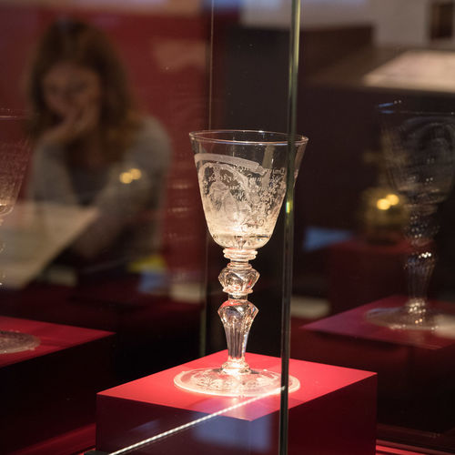 Wineglass with Engravings ArtWork Close-up Emperor's Glass Engravings Focus On Foreground Glass Illuminated Lifestyles Medieval Museum Non Recognizable Female Reflections Refreshment Selective Focus Still Life Wine Glass Wineglass