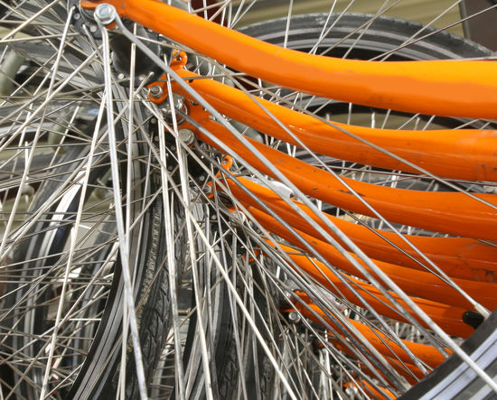 spokes of orange bicycles in a huge parking lot Transport Wheel Background Background Texture Backgrounds Bicycle Bicycles Bicycling Bike Bike Sharing Bike-share Bike-sharing Bikes Cycling Equipment Group Indsutry Spoke Spokes