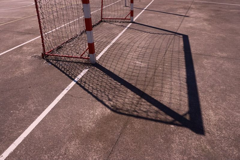 football sport shadow silhouette Football Soccer Sport Playing Play Field Goal Shadow Silhouette Ground Abstract Backgrounds Textured  Streetphotography Street City Bilbao SPAIN Park Rope Net Web Net - Sports Equipment Nature Outdoors Day