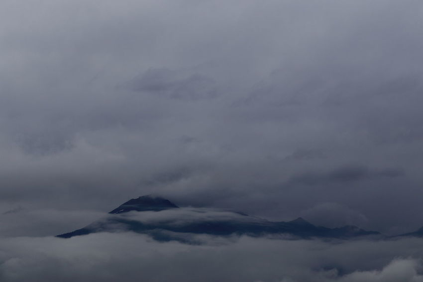 Mountain peeping through rain clouds. Background Bad Weather Clouds Dull Copy Space Depression Melancholic Gloomy Getting Inspired Gray Miles Away Pivotal Ideas Landscape Majestic Mountain In Clouds Mountain Range Mountains Natural Pattern Overcast Prättigau Rainclouds Remote Switzerland Color Palette White