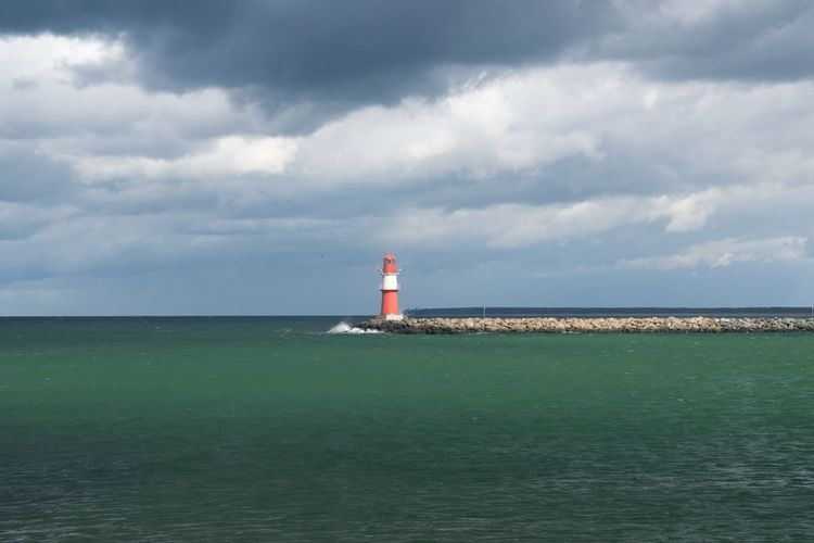 Guidance Lighthouse Sky Sea Water Protection Architecture Safety Built Structure Building Exterior Direction Building Cloud - Sky Security Nature Tower Horizon Day Horizon Over Water No People Outdoors Lighthouse Pier Mole