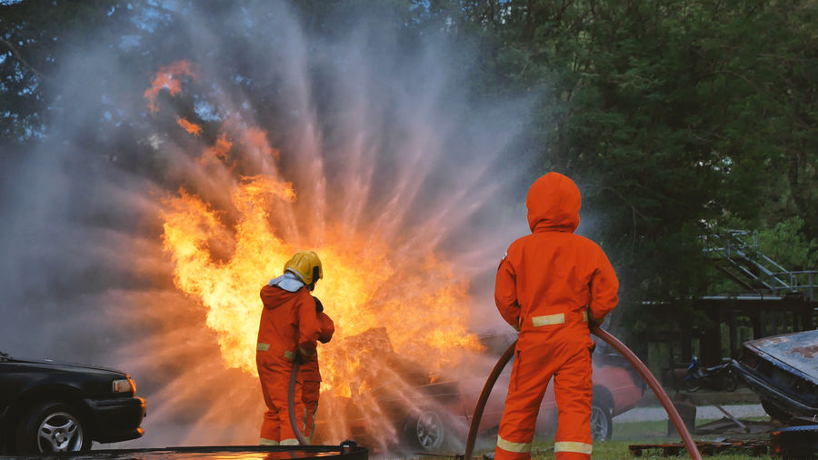Firefighters spraying water on fire