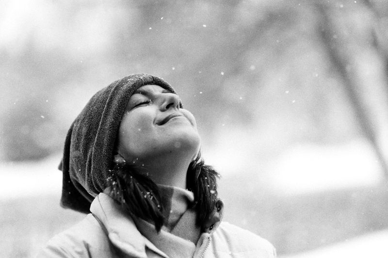 Gentle flakes. Naturesbeauty Showcase: January Deceptively Simple It's Cold Outside Winter_collection Lookingup Snow Film Filmisnotdead 35mm Film Black & White Portrait Sister Enjoying Life Happiness Security Gentle Happy Content Relaxed