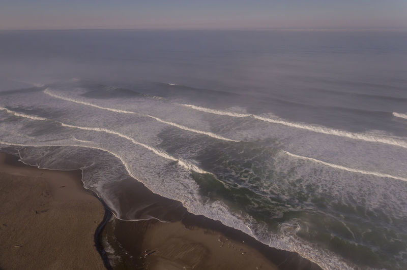 Aerial view of the beach in Lincoln City Oregon Sea Water Beauty In Nature Scenics - Nature Sky Nature Tranquility Beach No People Idyllic Horizon Horizon Over Water High Angle View Tranquil Scene Wave Outdoors Oregon Coast Pacific Northwest  Ocean Aerial View River Panoramic View Landscape Non-urban Scene