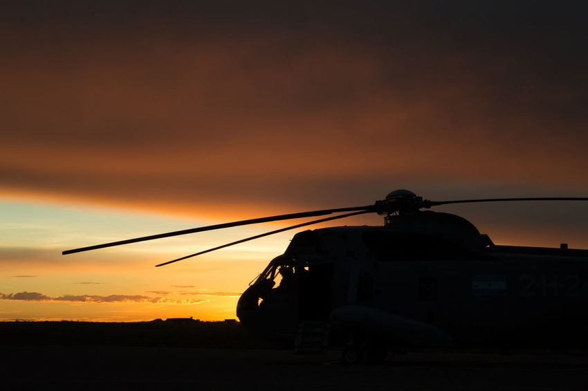 sea king helicopter silhouette Night Sunrise Sun Helicopter Chopper Rotor Blade Sun Yellow Red Horizon Landscape Military Sea King Sikorsky Uh3h Flight Fly Pilot PilotsLife Copilot Sunset Silhouette Technology Outdoors Sky Military Nature Day People First Eyeem Photo