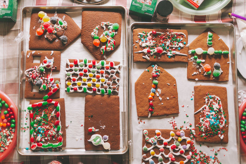 Gingerbread decorated for Christmas Holiday Moments Food And Drink Indoors  Table Gingerbread Christmas Baking Decorating Boys Children Candy Holidays Together Family Creative