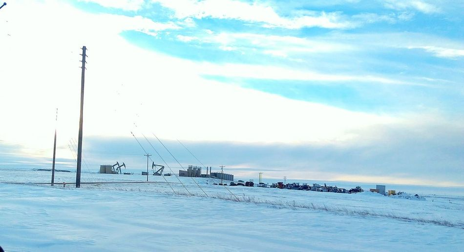 Winter time in williston north dakota, passing an oil field. Snow Sky Cold Temperature Winter Cloud - Sky Nature Tranquility Day Beauty In Nature Oil Oilfield, Oil Pump North Dakota Pipeline Fracking Industry Oil Industry Williston Oil Money No People Outdoors White Skylovers Sky Porn Winter Landscape Beautiful View First Eyeem Photo EyeEmNewHere