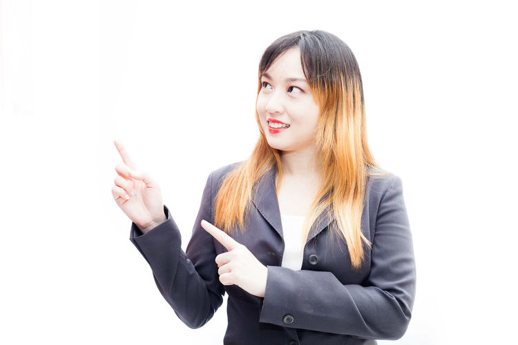 A young women posing with white background for commercial printing White Background Studio Shot Business Person Cut Out Businesswoman Hair Young Adult One Person Front View Waist Up Young Women Indoors  Business Hairstyle Women Standing Looking At Camera Copy Space Long Hair Beautiful Woman Bangs