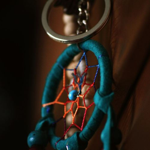 Close-up of turquoise dreamcatcher