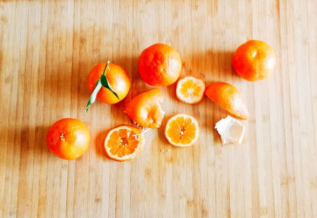 The orange fruit is on a wooden background. EyeEm Selects Fruit Food And Drink Healthy Eating Freshness No People Food Table Close-up Citrus Fruit Indoors  SLICE Wood - Material High Angle View Studio Shot Red Blood Orange Day