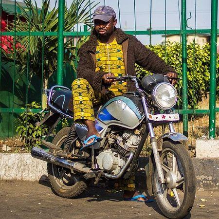 It is getting colder, look at his bear skin jacket! Lagos Nigeria Naija Okada tvs bike streetphotography africa