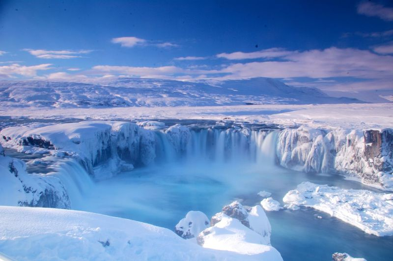 Scenic view of snowcapped landscape against sky godafoss