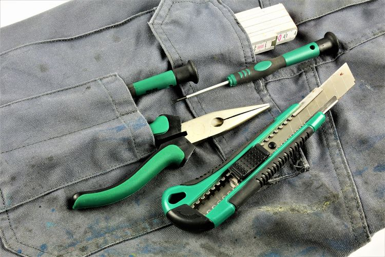 High angle view of hand tools with clothing