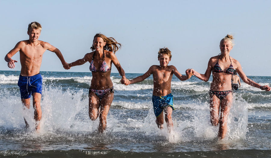 By The Sea Mediterranean  Fun In The Water Group Of People Leisure Activity Motion Outdoors Positive Emotion Real People Splashing This Is Family Togetherness Water Summer Exploratorium