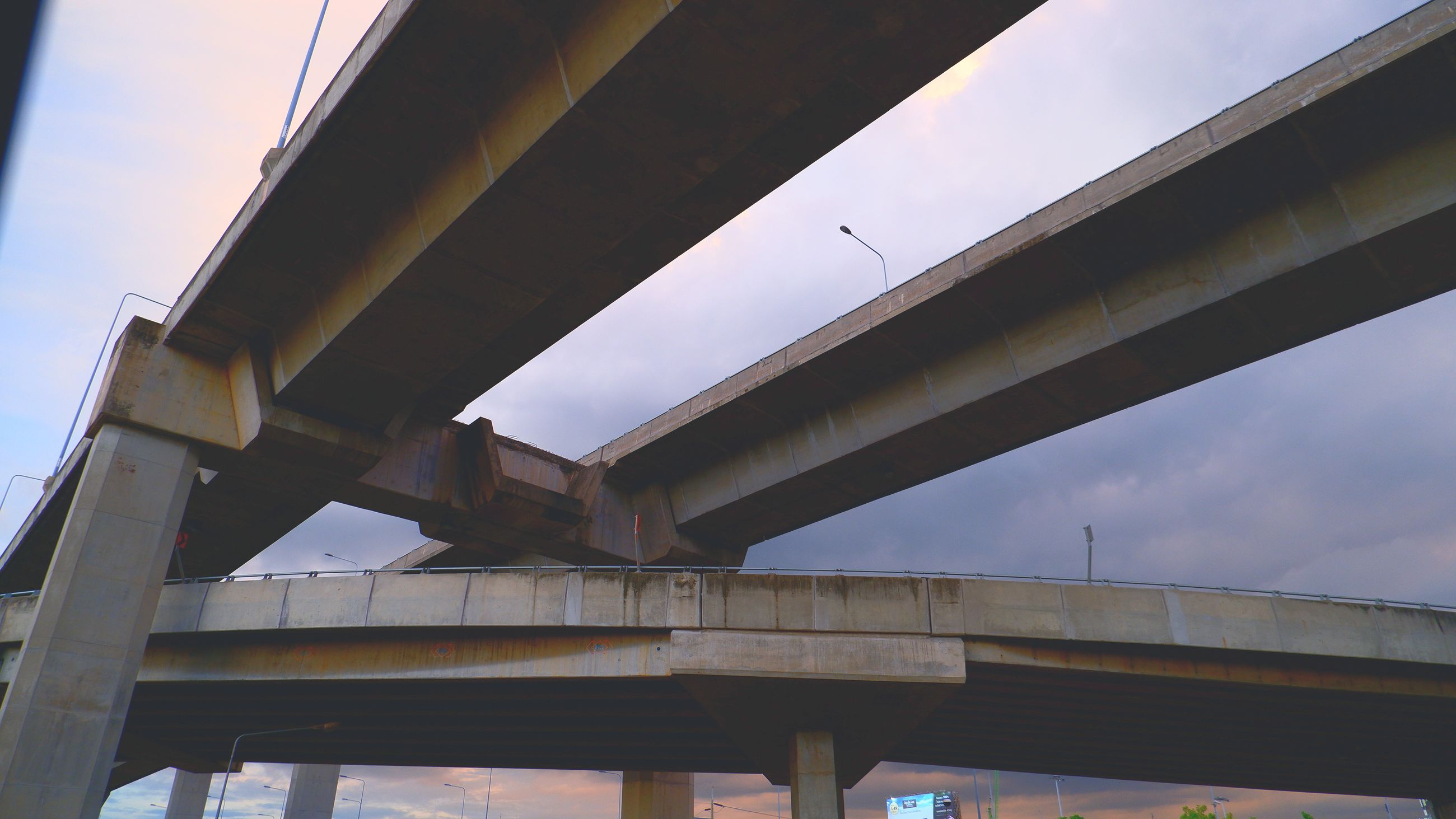 overpass, bridge, architecture, built structure, transport, public transport, transportation, girder bridge, beam bridge, sky, city, low angle view, engineering, nature, road, elevated road, highway, box girder bridge, architectural column, business finance and industry, multiple lane highway, outdoors, viaduct, concrete, travel