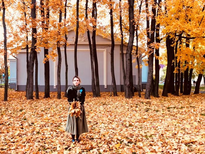 Autumn leaves. Girl play with leaves. Fields Square Trees Autumn Leaves Autumn Collection Autumn colors Real People Front View Lifestyles Leisure Activity Standing Full Length Women Day Young Adult Nature Looking At Camera Casual Clothing Young Women Outdoors Plant