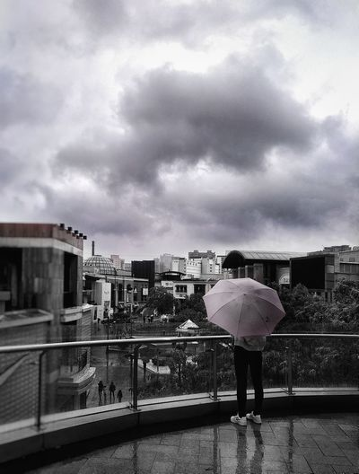Standing by People Umbrella Fashion Stories Shopping Center Square Politics And Government Full Length City Sky Architecture Cloud - Sky Built Structure Building Exterior