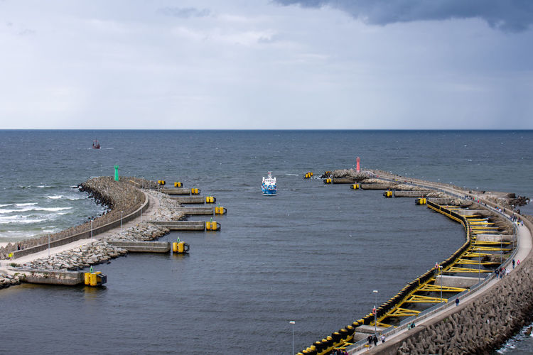 High angle view of pier over sea against sky