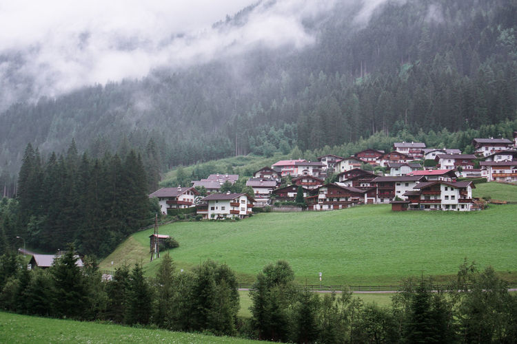 Scenic view of village and houses on mountain