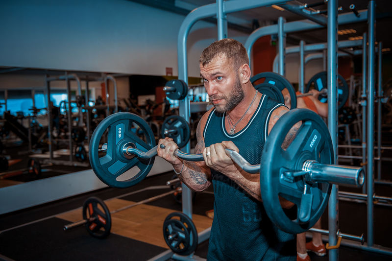 Muscular man exercising in gym
