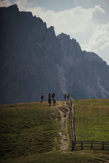 Sky Group Of People Men Nature Environment Land Landscape Real People Beauty In Nature Mountain Scenics - Nature Cloud - Sky People Lifestyles Grass Adult Plant Field Leisure Activity Group