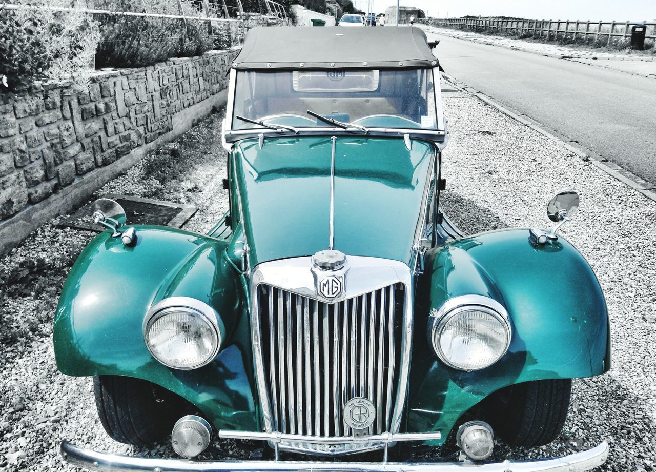 mode of transportation, transportation, day, retro styled, land vehicle, car, stationary, motor vehicle, vintage car, blue, no people, headlight, nature, outdoors, old, front view, metal, turquoise colored, field