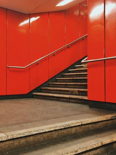 Staircase in illuminated corridor