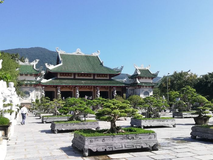 Temple outside building against clear sky