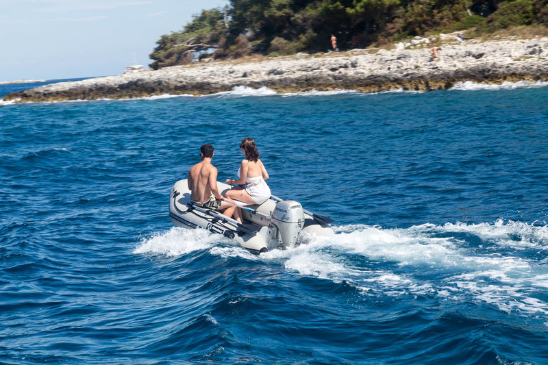 Couple in a speed boat... Couple Croatia Holiday Man Summertime Vrsar Croatia Woman Boat Couple - Relationship Couples Leisure Leisure Activities Leisure Activity Lifestyles Nature Outdoors People Sea Speedboat Summer Togetherness Two People Vacation Vrsar Water