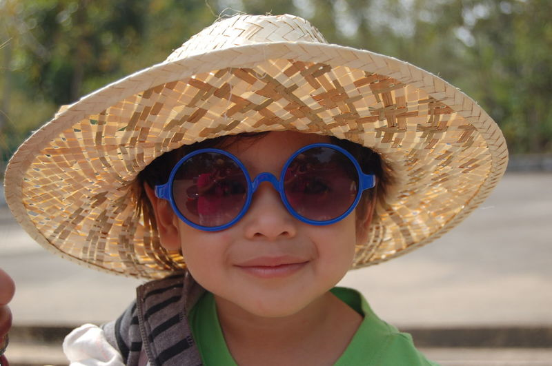 The joy of childhood Boys Child Childhood Close-up Clothing Fashion Focus On Foreground Front View Hat Headshot Innocence Leisure Activity Looking At Camera Males  Men One Person Outdoors Portrait Protection Real People Security Sun Hat Sunglasses
