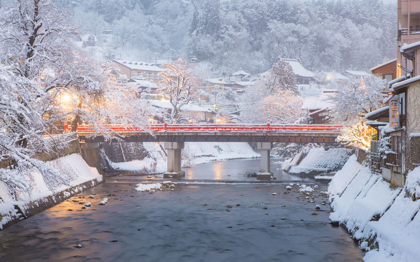 Nakabashi Bridge (Red Bridge) in winter, Takayama, Japan Snow Cold Temperature Winter Nature Built Structure Architecture Frozen Water No People Connection Bridge Transportation Bridge - Man Made Structure Reflection Covering Building Exterior Waterfront Day Snowing Extreme Weather Snowcapped Mountain