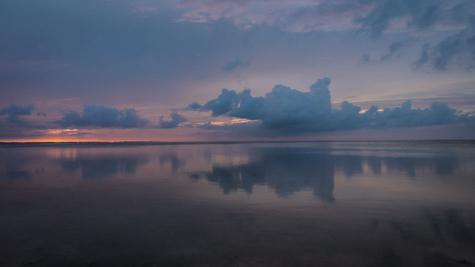 Beauty In Nature Blue Calm Cloud Cloudy Colors Of The Year Lake No People Non Urban Scene Orange Color Reflection Scenics Sky Standing Water Sunset Tranquil Scene Tranquility Water