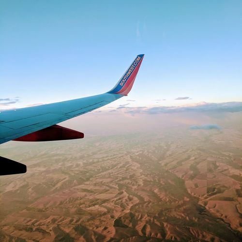 Airplane Aerial View Flying Blue Sky Air Vehicle Technology Outdoors Day Aerospace Industry No People Nature
