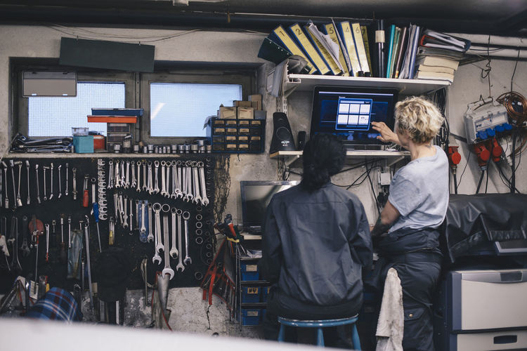 Rear view of people working