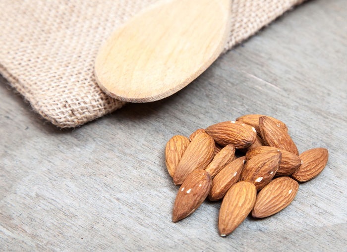 Close-up of almonds on wooden table