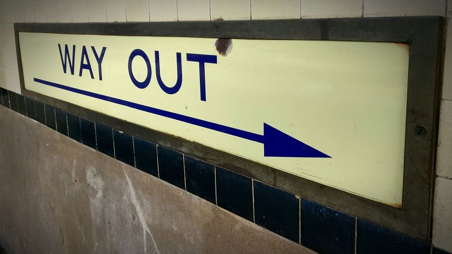 Pivotal Ideas Way Out Signal Sign Exit Arrow Pointing Right Old Sign Right Letters Western Script Way Out Sign Follow The Signs Showing The Way Underground Signs Blue Letters Blue Yellow No People Architectural Detail English Brexit EyeEm LOST IN London