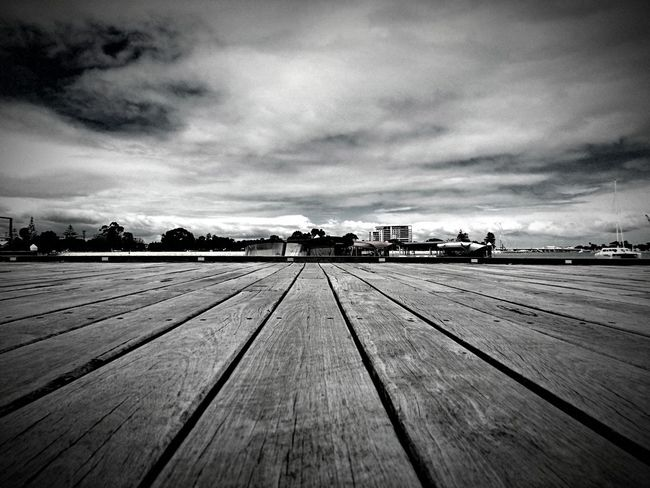 Boardwalk Sky Cloud - Sky Cloudy Boardwalk Day Nature Surface Level Tranquility Outdoors Scenics Tranquil Scene Beauty In Nature No People Rural Scene Storm Cloud Dramatic Sky Black And White XperiaZ5 Monochrome Photography Dramatic Angles Miles Away Welcome To Black