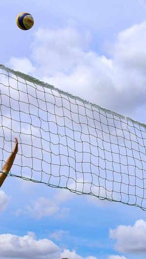 Cloud - Sky Sky Low Angle View Sport Ball One Person Outdoors Net - Sports Equipment One Man Only Beach Volleyball Day Soccer Competition Men Only Men Sportsman Soccer Field Nature Human Hand People