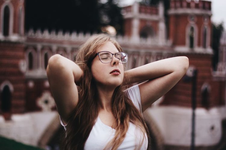 Close-Up Of Young Woman With Closed Eyes In City