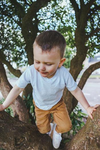 Full length of cute boy against trees