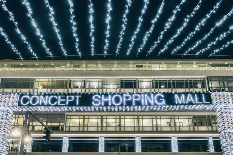 Illuminated 'Concept Shopping Mall' sign at Bikini shopping mall in Berlin, Germany 'Concept Shoping Mall' Architecture Berlin Bikini Shopping Mall Breitscheidplatz Building Exterior Built Structure Christmas Decoration City Color Image Germany🇩🇪 Horizontal Illuminated Night No People Outdoors Photography Text Travel Destinations